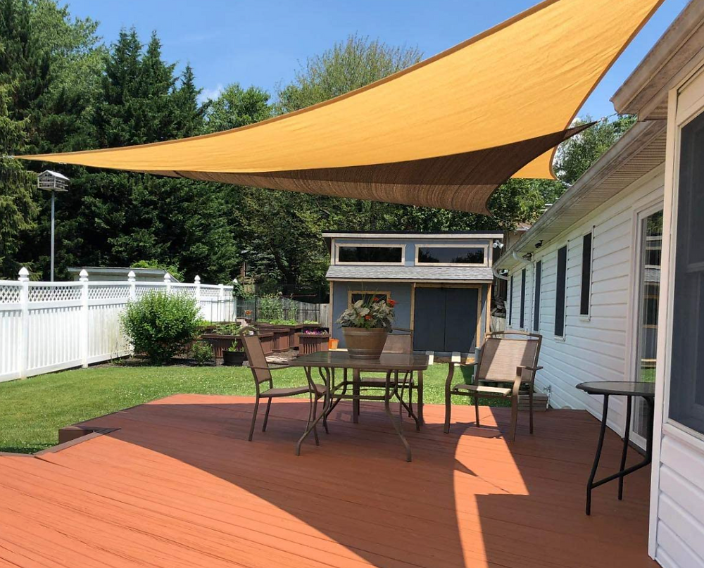 Shade sails providing coverage and shade on a deck.