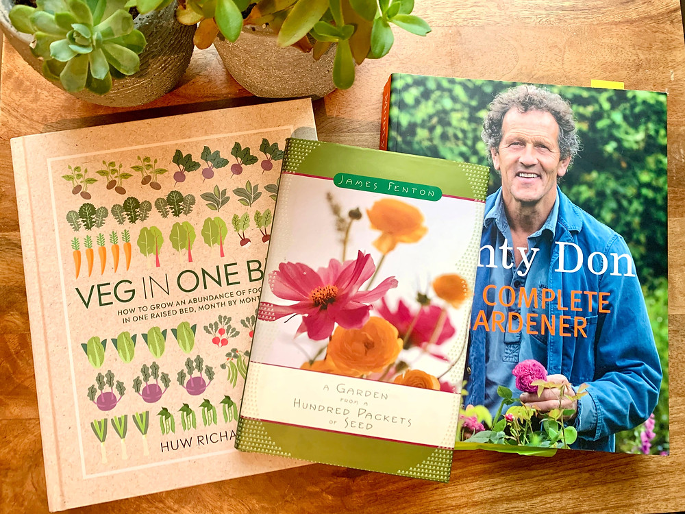 My favorite wintertime books on gardening including Monty Don's The Complete Gardener, Veg in One Bed and Fenton's A Garden from a Hundred Packets of Seeds.