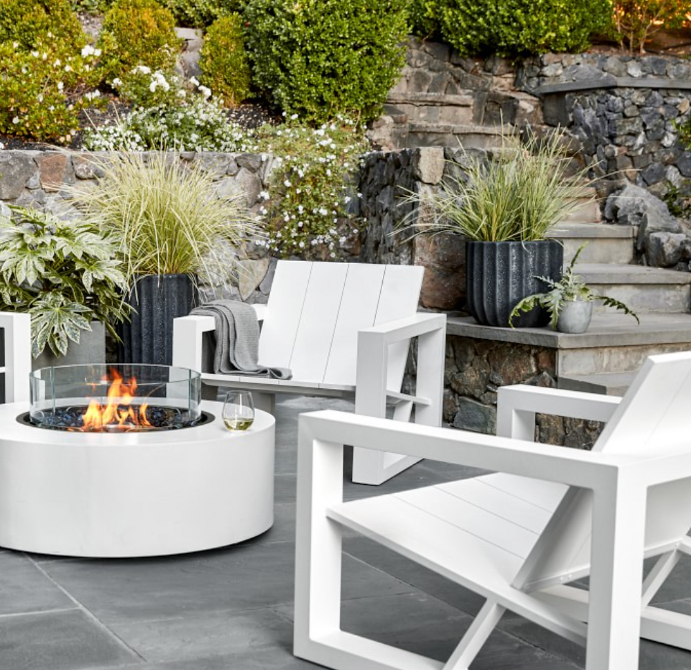 Fluted outdoor Maris planters on patio with plants by Williams Sonoma.
