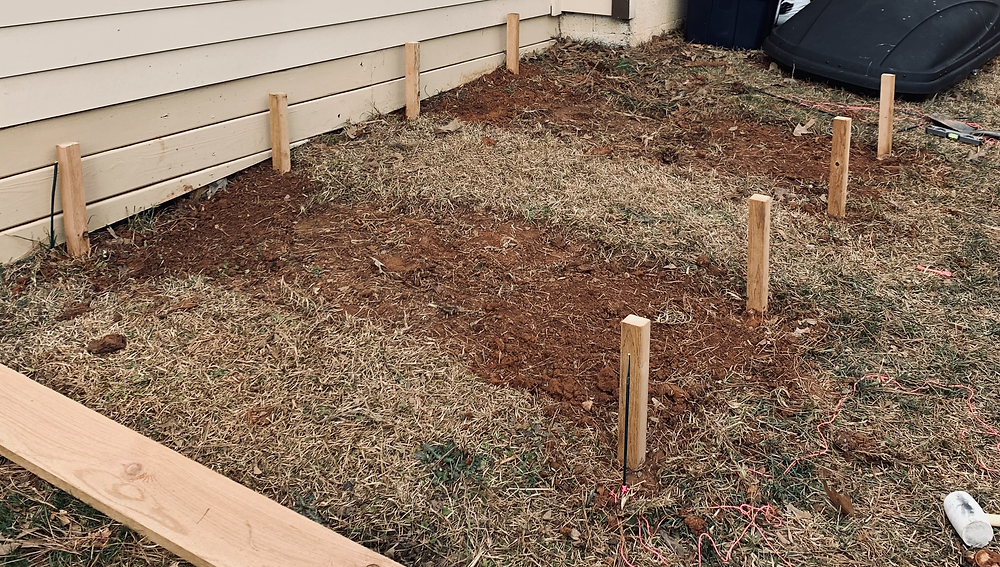 I skimmed off the layer of grass and will till this further before add soil into the planters.