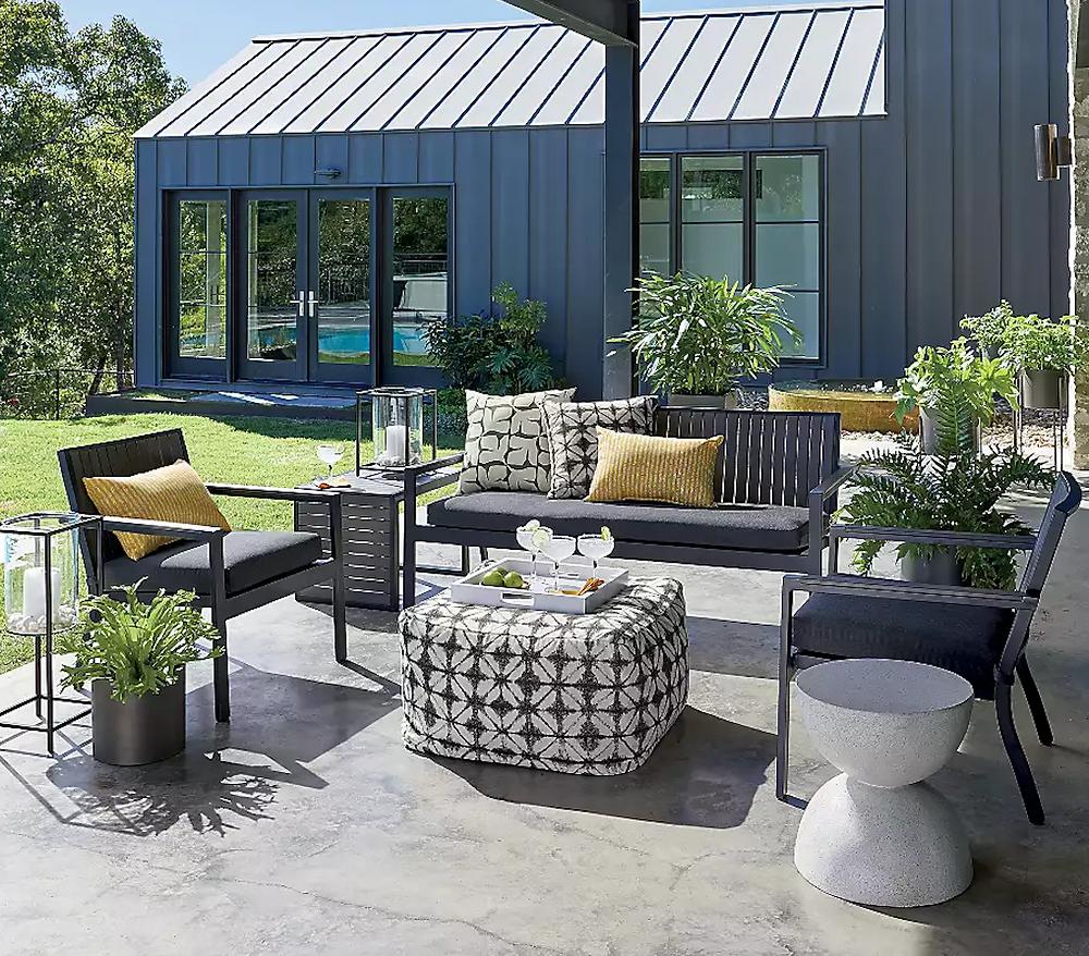 Bronze outdoor floor planters on a patio from Crate & Barrel.
