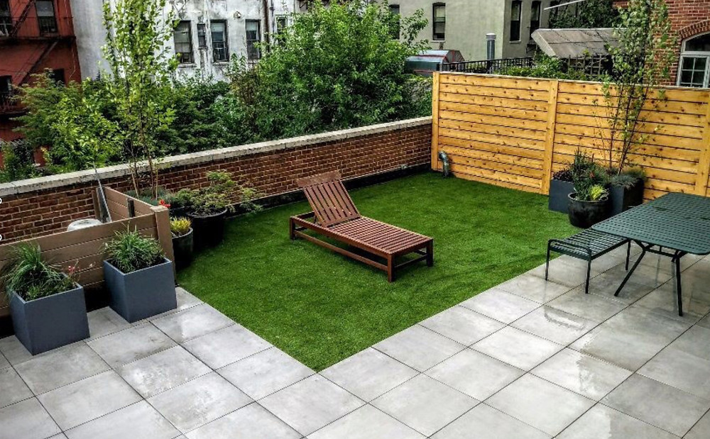 A NYC rooftop garden with porcelain pavers on a pedestal system from Archatrak.