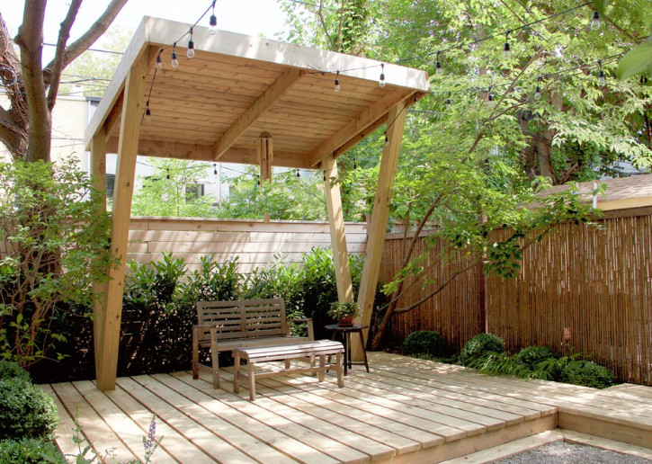 A cedar pergola provides shade in this Brooklyn backyard garden. Image courtesy Staghorn.