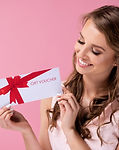 Beautiful woman giving a gift voucher .j