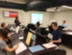 Barbara Fast teaching piano students at OU
