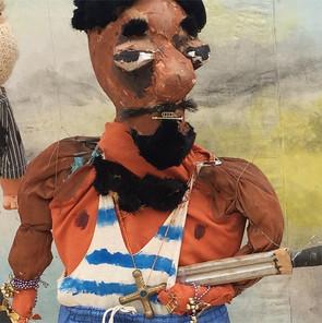 Einer der Räuber, die in  dem Stück von Don Quichotte verjagt werden.