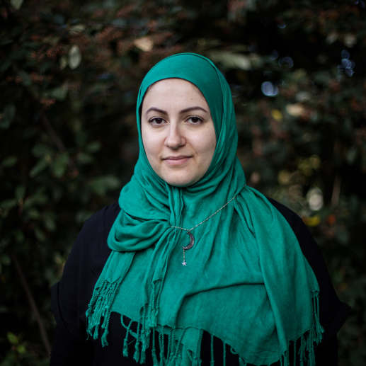 """""""I bought this necklace a few years ago. It's almost identical to the one I had when I was a child. Years before I could even know what Islam was. Coincidence?"""" Noor is an Italian convert living in London. She converted after meeting her (now) ex-husband. Although he wore it for this portrait,  she stopped wearing her hijab in public after she became Muslim."""