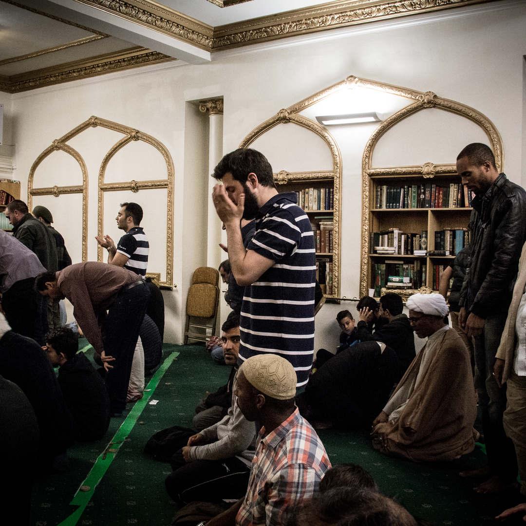 A British Shia convert prays at the Islamic Centre of England.