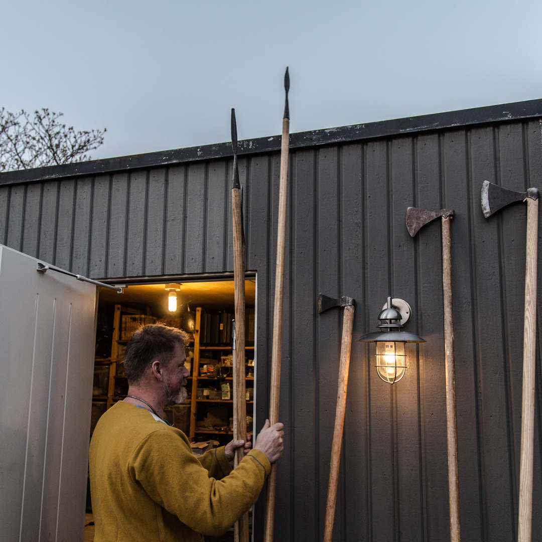 Ola stores his spears in his garage.