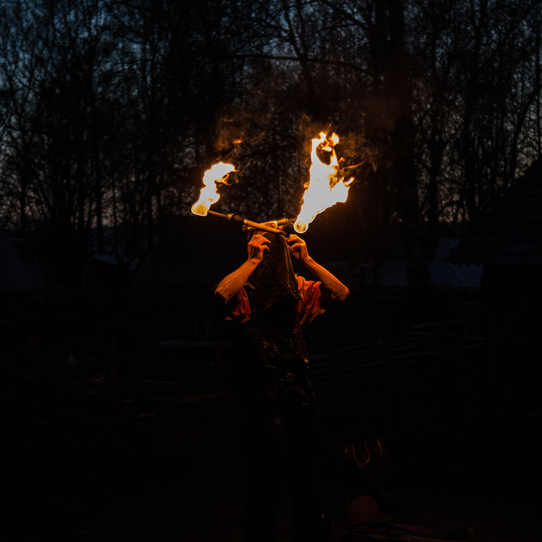 A performer plays with fire.