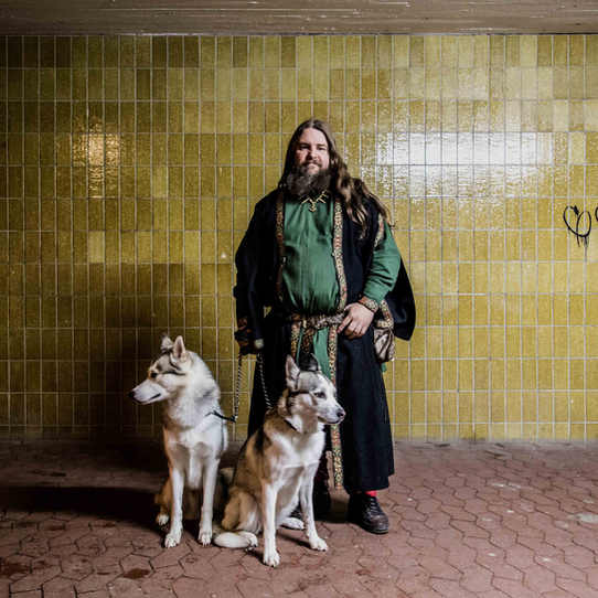 Carl Mikael, a Viking priest and self-professed historian, with his dogs in Malmo.
