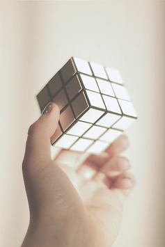 person%20holding%203%20x%203%20rubiks%20