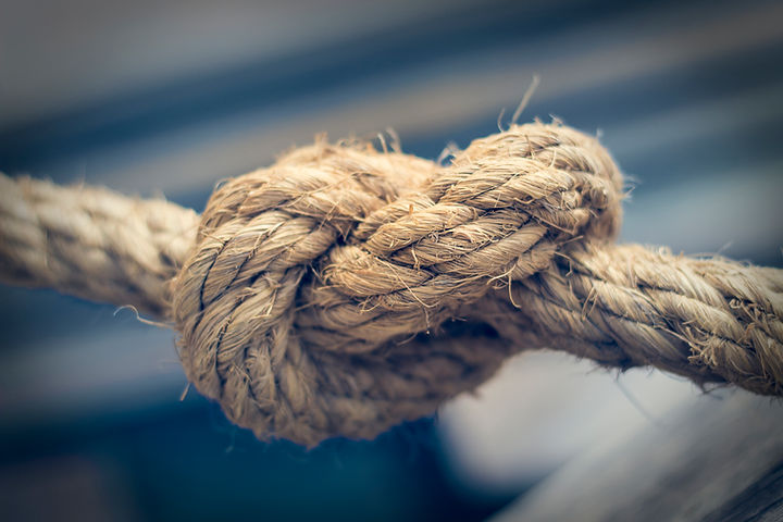 Close up of the detail and texture of a knotted rope