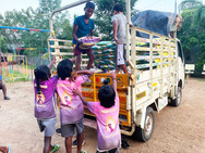 unloading rice to help poor in India