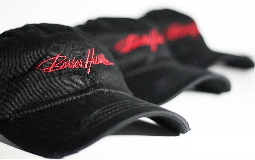 black distressed dad hat / red lettering