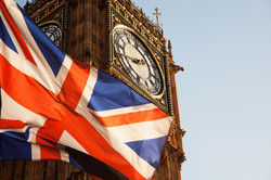 union jack flag and iconic Big Ben at the palace of Westminster, London - the UK prepares for new el
