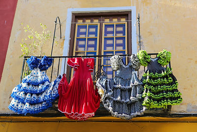 Traditional flamenco dresses at a house