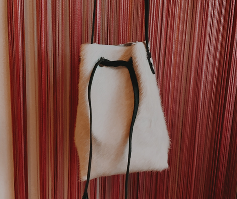 """BRINGS THE FUN"" Bucket Bag in White Calfhair"