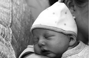 Sleeping cute baby on mum's shoulder