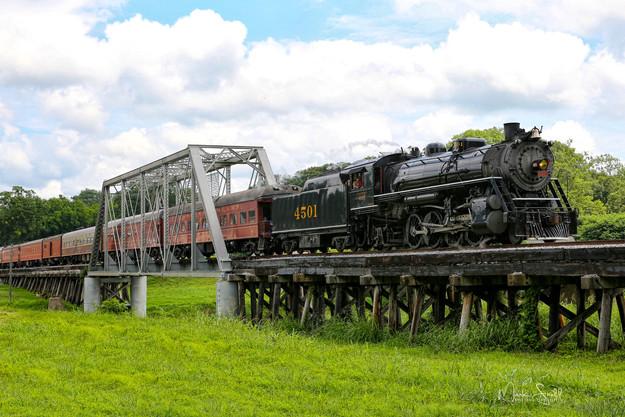 train passing through bridge.jpg