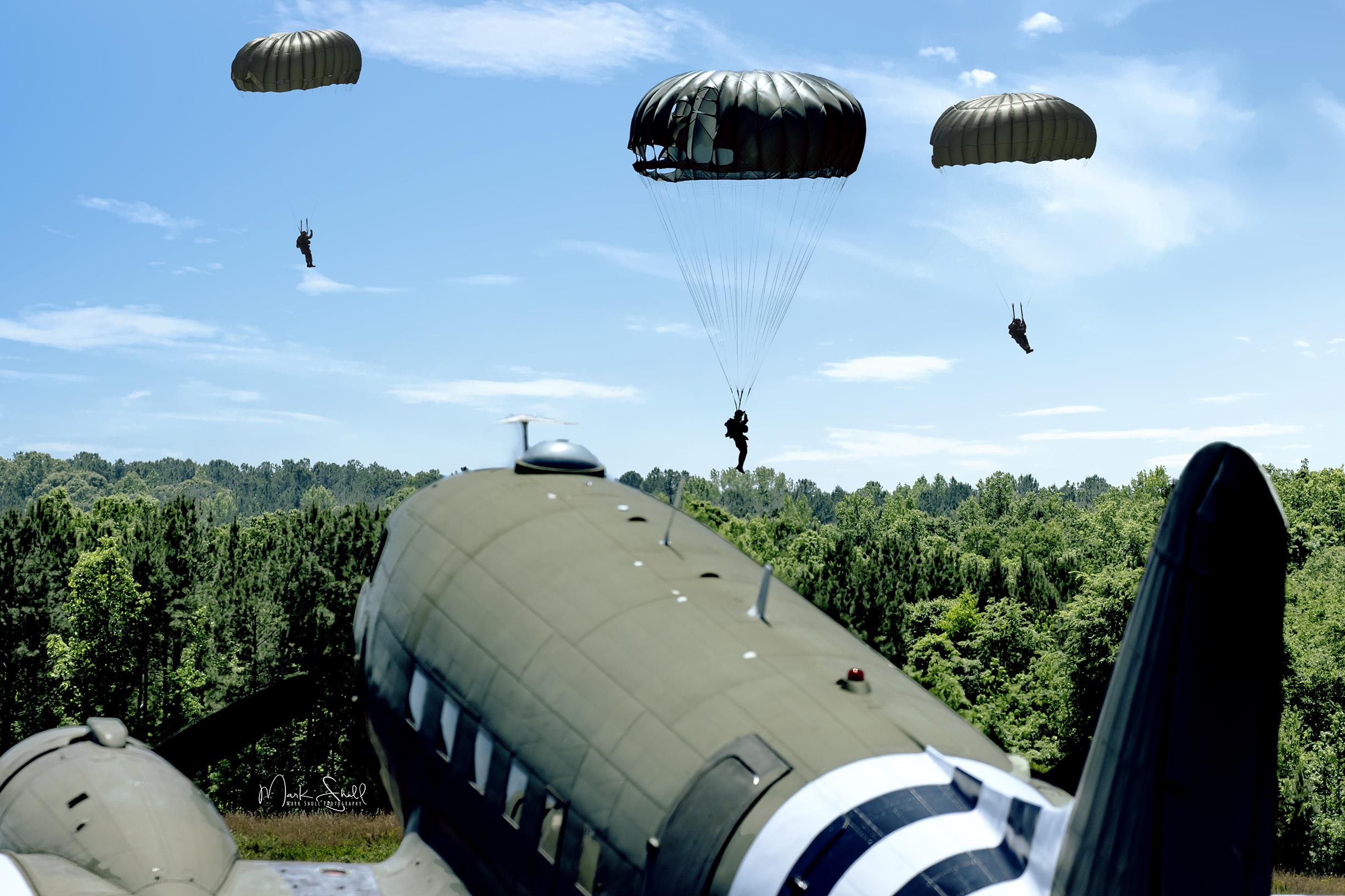 Paratroopers landing over C-47