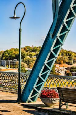 Veterans Bridge lamp flowers bench