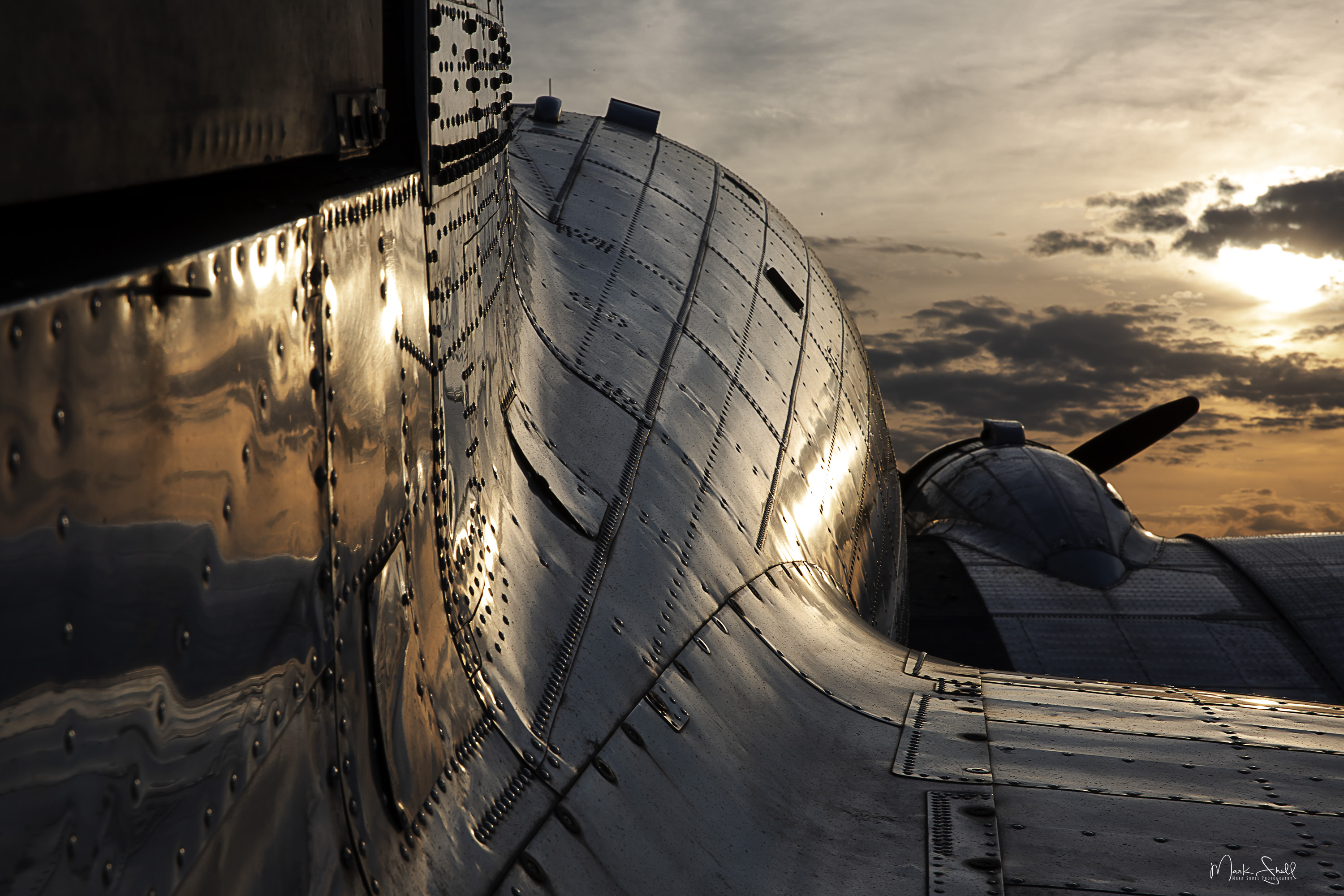 WWII DC-3 sunset reflection post