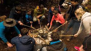 The group getting to grips with cooking in the wild