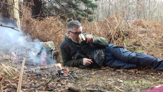 Weresie enjoying a cuppa with a small, controlled fire