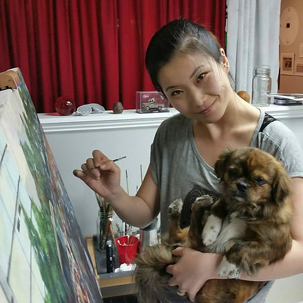 Fei Lu and her dog Pongo painting.