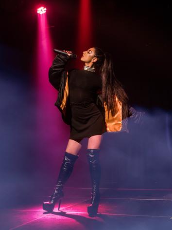 Amy G as Ariana Grande