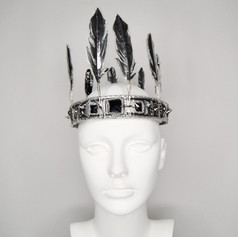 Plastic Crown with Trapped Feather