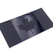 Black on black Canadian flag heading up
