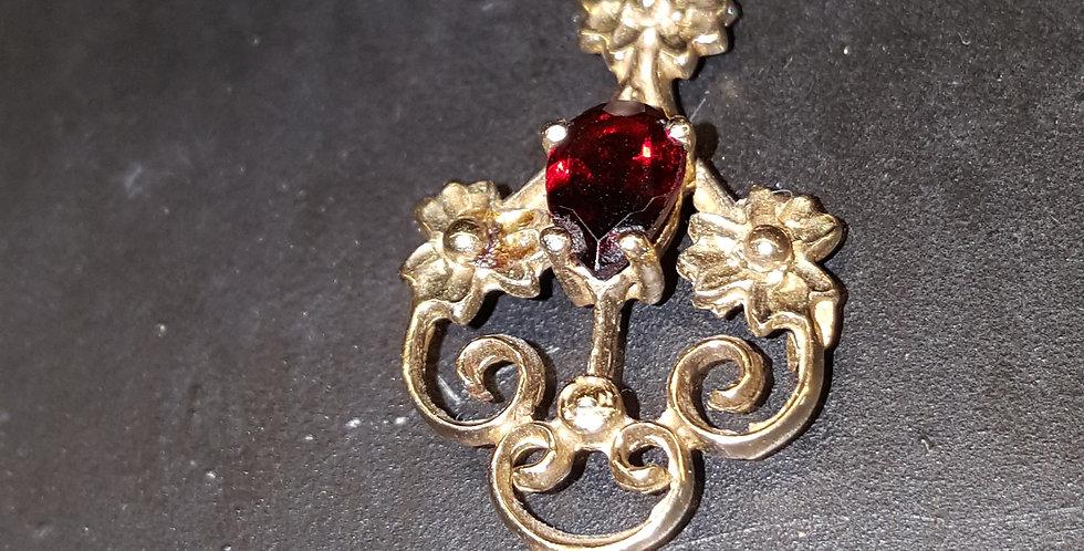 Gold and Garnet Pendant