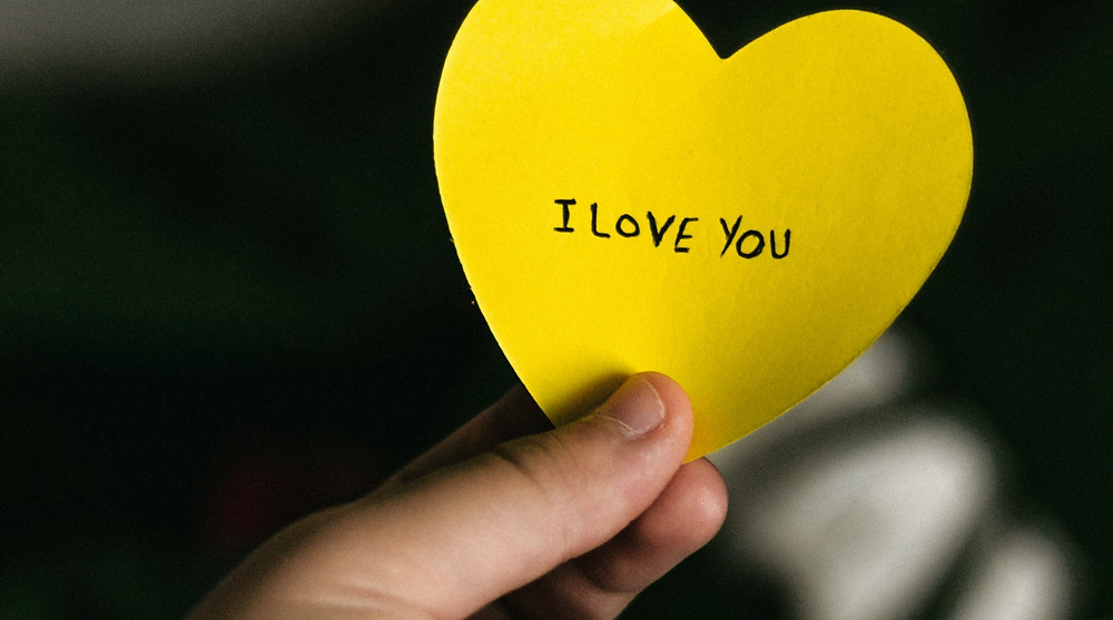 """Thoughtful love note with caption """"I love you"""""""