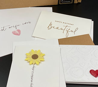 Occasion cards spread out in front of you:MoreThoughtful packaging.  Includes birthday card, Mother's Day card, anniversary card, and Valentine's Day card.