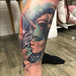 Unicorn girl head tattoo by Skye