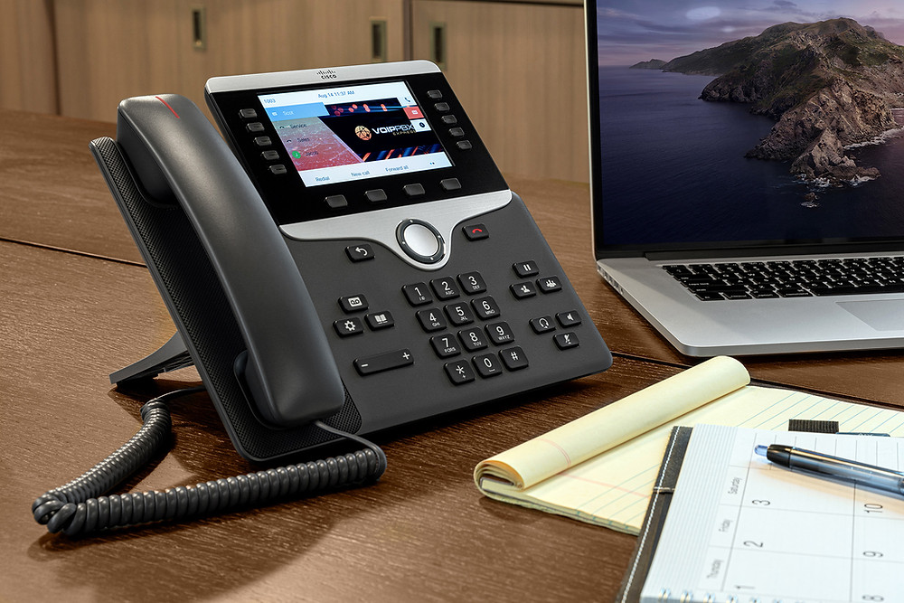 Cisco IP PBX Phone System with Color Phones on wooden table
