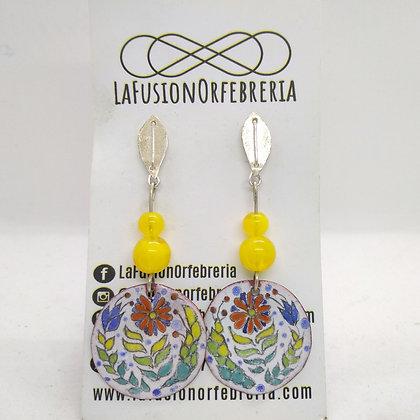 Hoja, aragonitas y medalla floral