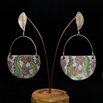 Gota y medalla floral