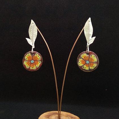 Hojita y medalla floral
