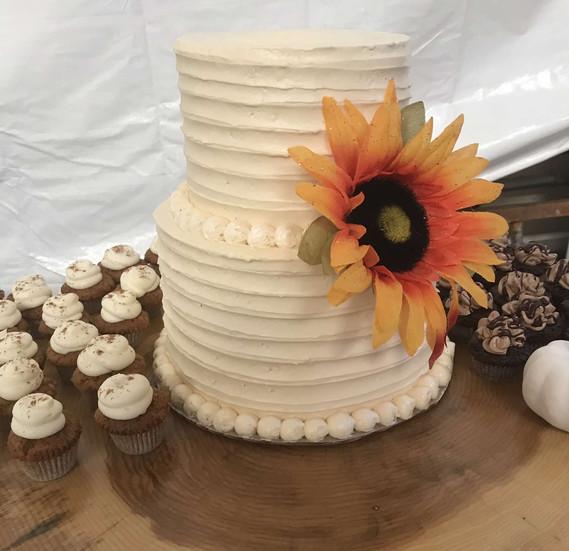 mini cupcakes witha two tier cake