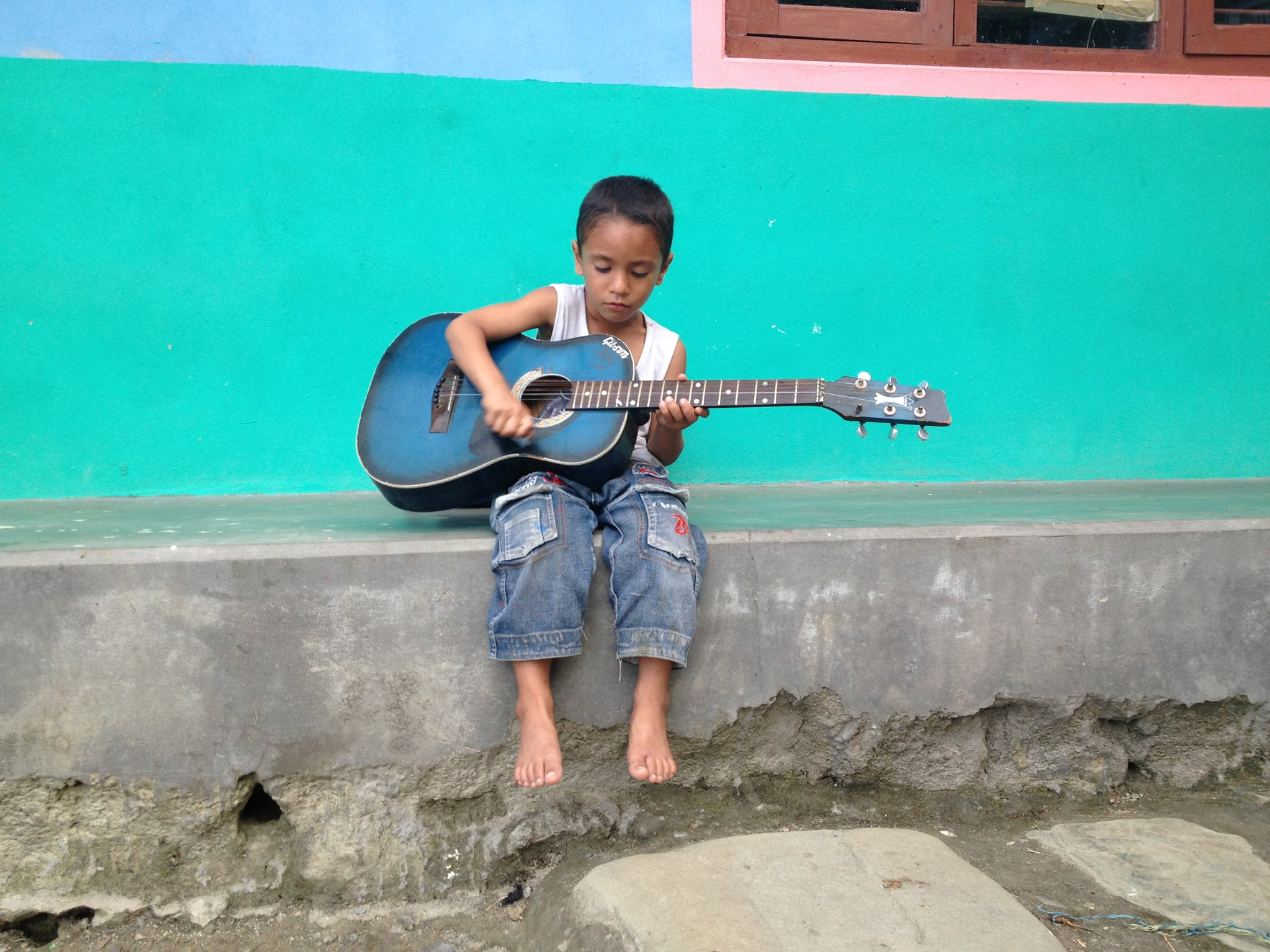 Ashim playing the guitar