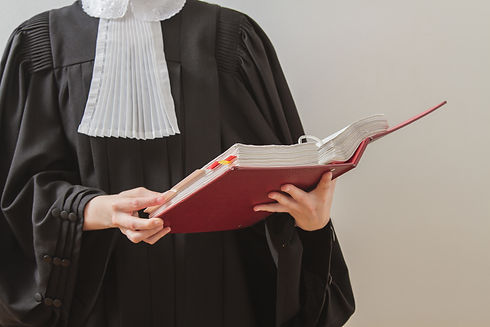 canadian lawyer in toga, reading from a