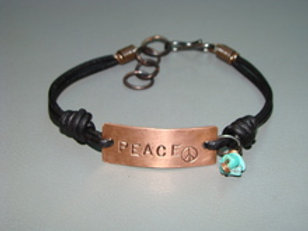 """Give Peace a chance"" shown w/natural stone on leather w/ lock"