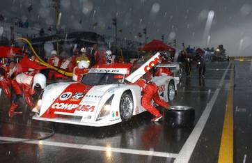 Ganassi GA Car Pit Stop in Heavy Evening Rain
