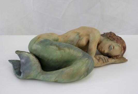 Sleeping mermaid sculpture