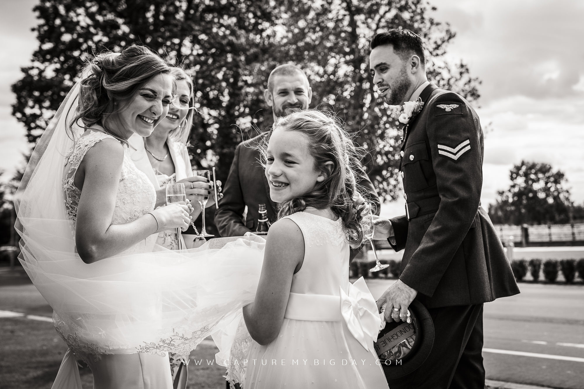 bride and groom having a drink