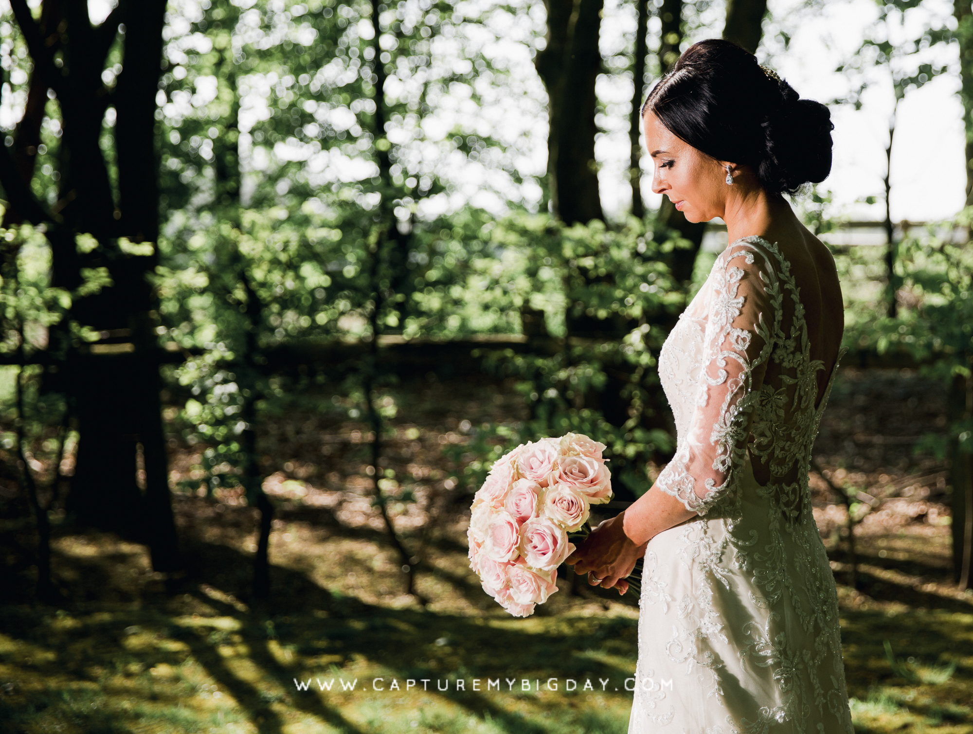 Bride standing in the woods