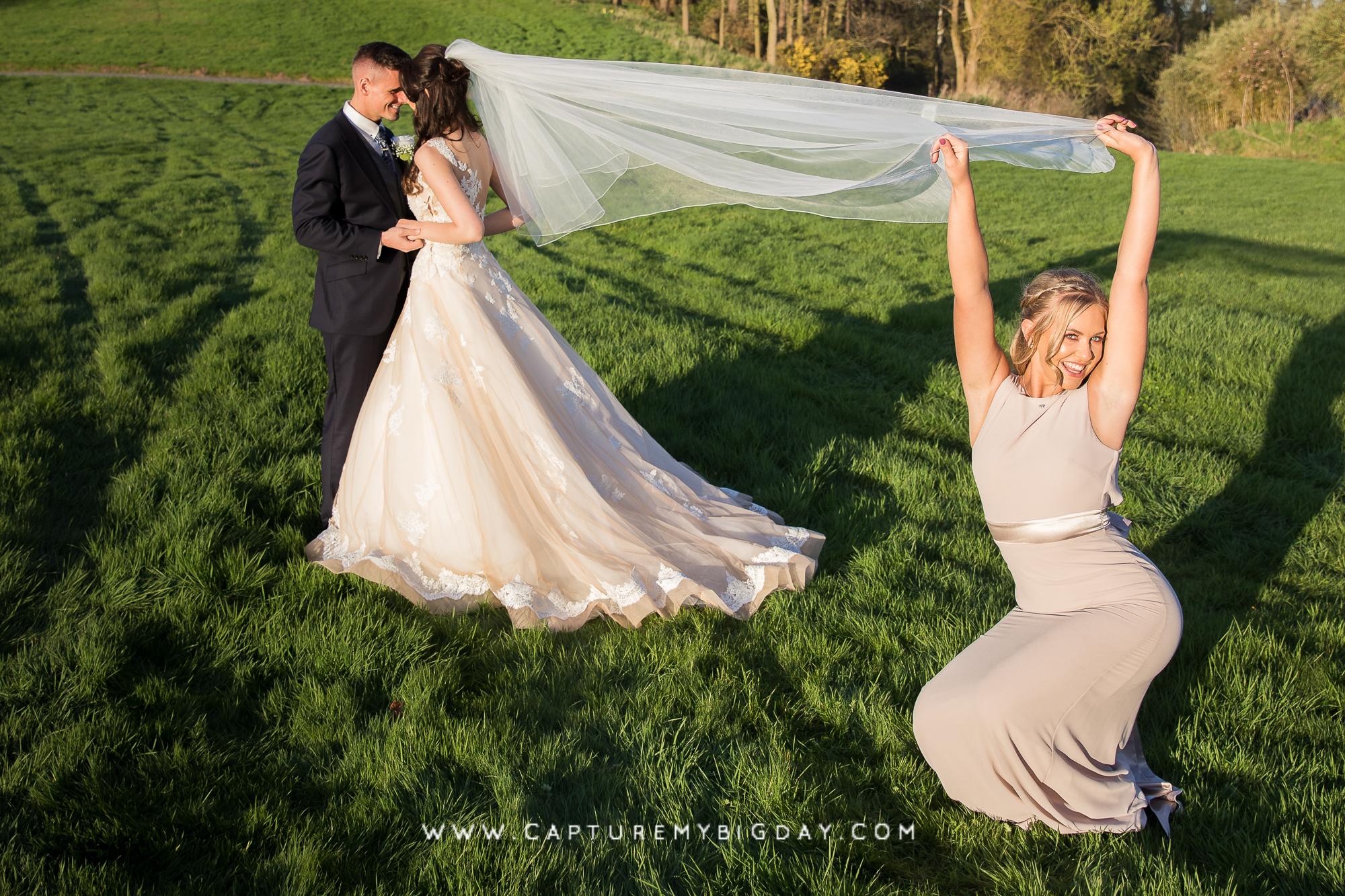 bridesmaid holding veil